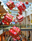 Bright hanging Christmas presents Royalty Free Stock Images