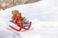 Teddy bears sledding in the winter snow Royalty Free Stock Photography