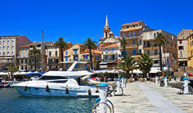 Bright harbor, Calvi, Corsica. Pretty harbor with boats, cafes, and walkways, Calvi, Corsica, France Royalty Free Stock Image