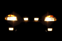 Bright headlights. Of car at night Royalty Free Stock Images