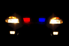 Bright headlights of police car. At night Stock Photography