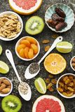 Bright healthy ingredients for proper nutrition: fruits, nuts, berries, superfood, orange, grapefruit, almonds, dried. Bright healthy ingredients for proper Stock Photo