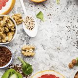 Bright healthy ingredients for proper nutrition: fruits, nuts, berries, superfood, orange, grapefruit, almonds, dried. Bright healthy ingredients for proper Royalty Free Stock Photos