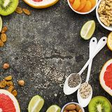Bright healthy ingredients for proper nutrition: fruits, nuts, berries, superfood, orange, grapefruit, almonds, dried. Bright healthy ingredients for proper Stock Images