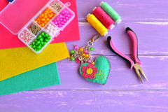 Bright heart keychain with flower, beads. Stock Photos