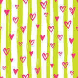 Bright heart pattern. Bright pink heart confetti seamless pattern on lime striped background Royalty Free Stock Photography