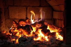 Bright heat and hot coals in the fireplace. Graphic of fire. Flames brickwork red orange Stock Photography
