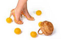 Bright high heeled shoes and oranges Royalty Free Stock Image