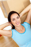 Bright hispanic woman relaxing between boxes Stock Image