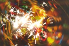 Bright holiday sparkler royalty free stock photography
