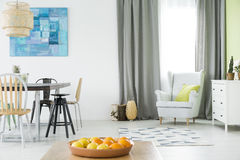 Bright home interior with table stock photography