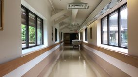 Bright hospital corridor view stock video
