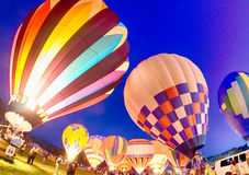 Bright Hot Air Balloons Glowing at Night Stock Photos