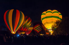 Bright Hot Air Balloons Glowing at Night Stock Image