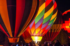 Bright Hot Air Balloons Glowing at Night Stock Images