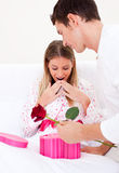 Bright husband giving a present to his wife Royalty Free Stock Image