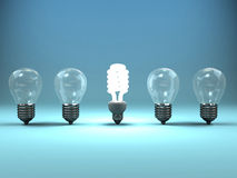Bright Idea. A 3d image of four lamps and one shining luminescent lamp Royalty Free Stock Photography