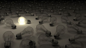 Bright idea. A lit light bulb surrounded by dark ones Royalty Free Stock Image