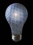 Bright Idea. A light bulb with the reflection of building. The building has a glare in the middle stock image