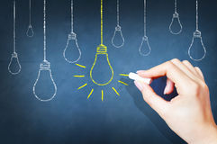 Bright idea on blackboard concept Royalty Free Stock Images