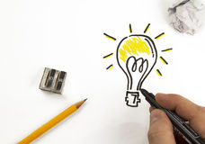 Bright Idea. Bulb immersed in a world of colors Royalty Free Stock Photos