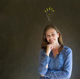 Bright idea lightbulb thinking business woman Royalty Free Stock Photography