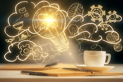 Bright idea concept. Close up of desktop with coffee cup, notepad, pen and yellow lamp drawing. Bright idea concept Stock Photography
