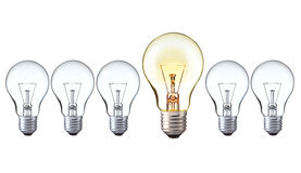 Bright idea concept: on and off light bulbs in row with copy space. Turn on big light bulb in front of turn off bulbs, Big idea concept, Bright Creative and stock photo