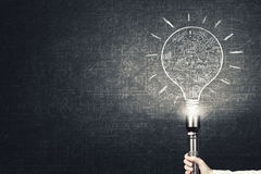 Bright idea in darkness royalty free stock photos