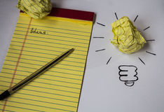 Bright idea drawn on paper pen notebook Stock Image