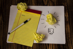 Bright idea drawn on paper pen notebook Royalty Free Stock Image