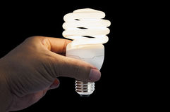 Bright idea in hand on black background Royalty Free Stock Photos