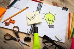 Bright idea. Opened personal organizer.Bright idea Stock Images