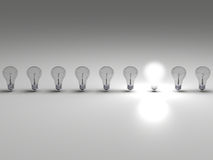 Bright idea. Row of lightbulbs, concept of one bright idea Stock Photography