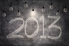Bright ideas in 2013 with light bulbs Stock Images