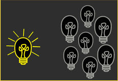 Bright Ideas. On black background Royalty Free Stock Photo