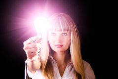 Bright incandescent bulb in woman hands Stock Photography