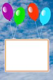 Bright inflatable balloons with a clean placard Royalty Free Stock Photography