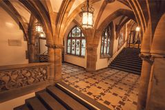 Bright interior with arches of gothic style New Town Hall, Neues Rathausbuilt in 1908. Munich. MUNICH, GERMANY - NOVEMBER 17, 2017: Bright interior with arches Royalty Free Stock Images