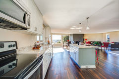 Bright interior of kitchen with large kitchen island stock photos
