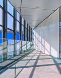 Bright Interior of a modern office building with large windows, royalty free stock image