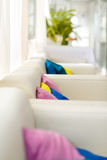 Bright interior with white sofa and colorful pillows Stock Photo