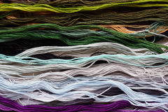 Bright iridescent thread floss for embroidery and needlework. Sewing threads for embroidery close-up. Stock Images