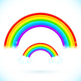 Bright isolated vector rainbows with clouds. In cartoon style Stock Photos