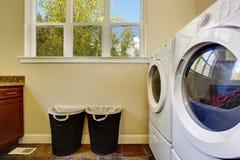 Bright ivory laundry room stock image