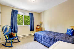 Bright ivory room with blue curtains and bed Stock Photos