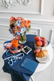 Bright and juicy color Wedding bouquet different flowers. Modern bridal bunch with orange tulips, red gloriosa, blue Stock Photo