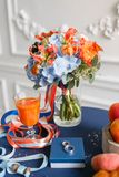 Bright and juicy color Wedding bouquet different flowers. Modern bridal bunch with orange tulips, red gloriosa, blue Royalty Free Stock Images