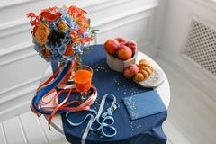 Bright and juicy color Wedding bouquet different flowers. Modern bridal bunch with orange tulips, red gloriosa, blue Stock Photos
