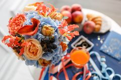 Bright and juicy color Wedding bouquet different flowers. Modern bridal bunch with orange tulips, red gloriosa, blue Stock Images
